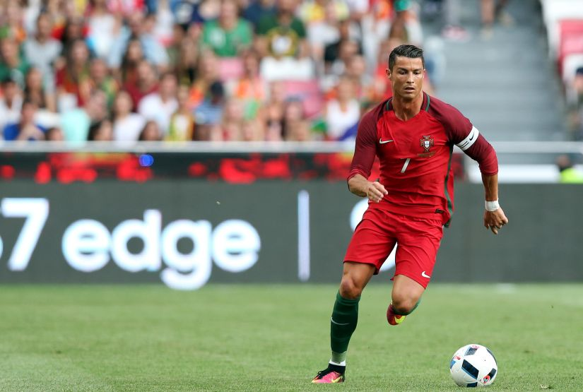 Portugal's Cristiano Ronaldo controls the ball during their friendly soccer match against Estonia at Benfica stadium in Lisbon, Wednesday, June 8 2016. Portugal will play in the Euro2016 in Group stage against Austria, Hungary and Iceland in Group F. (AP Photo/Steven Governo)